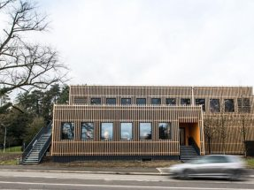 Two-story employee restaurant with sustainable wood facade cladding.