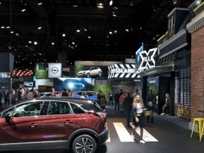 Picture: Opel is presenting its first hybrid vehicle in a natural setting with a green double-deck exhibition stand on a